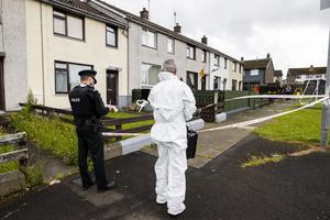 Police attend the scene at a property on Orkney Drive in Ballymena, County Antrim, as a murder investigation is under way following the death of a man at a house. (Liam McBurney/RAZORPIX)