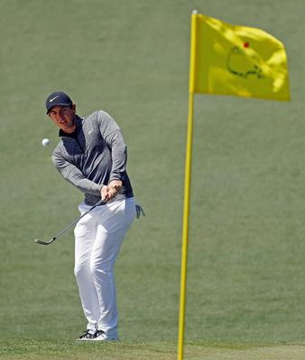 Rory McIlroy, of Northern Ireland, chips to the second green during the first round of the Masters golf tournament Thursday, April 7, 2016, in Augusta, Ga. (AP Photo/Chris Carlson)