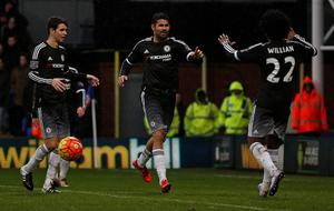 Chelsea's Brazilian-born Spanish striker Diego Costa (C) celebrates scoring his team's third goal with Chelsea's Brazilian midfielder Oscar (L) and Chelsea's Brazilian midfielder Willian during the English Premier League football match between Crystal Palace and Chelsea at Selhurst Park in south London on January 3, 2016. AFP PHOTO / ADRIAN DENNIS  RESTRICTED TO EDITORIAL USE. NO USE WITH UNAUTHORIZED AUDIO, VIDEO, DATA, FIXTURE LISTS, CLUB/LEAGUE LOGOS OR 'LIVE' SERVICES. ONLINE IN-MATCH USE LIMITED TO 75 IMAGES, NO VIDEO EMULATION. NO USE IN BETTING, GAMES OR SINGLE CLUB/LEAGUE/PLAYER PUBLICATIONS.ADRIAN DENNIS/AFP/Getty Images