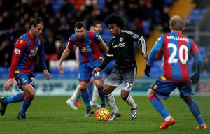 Chelsea's Brazilian midfielder Willian (2nd R) vies with Crystal Palace's French-born Moroccan striker Marouane Chamakh (L), Crystal Palace's Scottish midfielder James McArthur and Crystal Palace's Welsh midfielder Jonathan Williams (R) during the English Premier League football match between Crystal Palace and Chelsea at Selhurst Park in south London on January 3, 2016. Chelsea won the game 3-0. AFP PHOTO / IKIMAGES  RESTRICTED TO EDITORIAL USE. NO USE WITH UNAUTHORIZED AUDIO, VIDEO, DATA, FIXTURE LISTS, CLUB/LEAGUE LOGOS OR 'LIVE' SERVICES. ONLINE IN-MATCH USE LIMITED TO 45 IMAGES, NO VIDEO EMULATION. NO USE IN BETTING, GAMES OR SINGLE CLUB/LEAGUE/PLAYER PUBLICATIONS.IKIMAGES/AFP/Getty Images