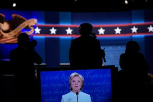Democratic presidential nominee Hillary Clinton is seen speaking on a TV screen during the final presidential debate at the Thomas & Mack Center on the campus of the University of Las Vegas in Las Vegas, Nevada on October 19, 2016. / AFP PHOTO / Brendan SmialowskiBRENDAN SMIALOWSKI/AFP/Getty Images