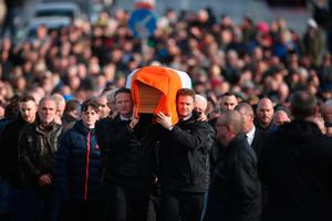 The sons of Northern Ireland's former deputy first minister and ex-IRA commander Martin McGuinness , Fiachra (left) and Emmet, carry his coffin to his home in Derry after he died aged 66. Pic: Niall Carson/PA Wire