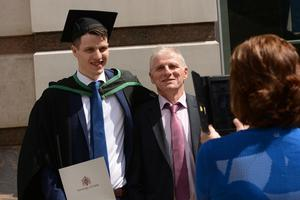 HARRISON PHOTOGRAPHY - BELFAST - 1st July 2016 Graduating from Ulster University today with a degree in ICT is Niall Hagan with mum Mary doing the pictures of him and dad Tommy