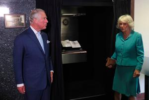 The Prince of Wales and Duchess of Cornwall unveiling the Police Service of Northern Ireland Memorial Book during a visit to the PSNI HQ  in Belfast as part of their visit to Northern Ireland. Brian Lawless/PA Wire