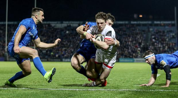 Ulster winger Angus Kernohan scores their first try despite the interests of Leinster duo Robbie Henshaw and Fergus McFadden (INPHO/Dan Sheridan)