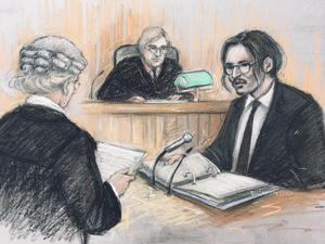 Court artist sketch of Johnny Depp being cross-examined by Sasha Wass QC before Mr Justice Nicol at the High Court (Elizabeth Cook/PA)