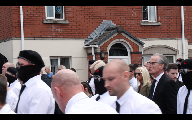 Sinn Fein MLA Gerry Kelly at the funeral of Martin McElkerney.