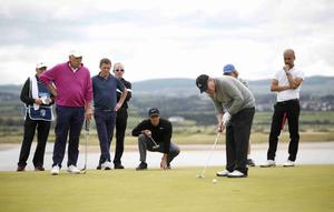 PressEye Belfast - Northern Ireland - 5th July 2017  Rory McIlroy helps line up a putt on the 6th green for JP McManus as AP McCoy and Pep Guardiola look during the Pro-Am at the Dubai Duty Free Irish Open Golf Championship at Portstewart Golf Club. Picture by Peter Morrison/PressEye.com   Picture by Peter Morrison/PressEye.com