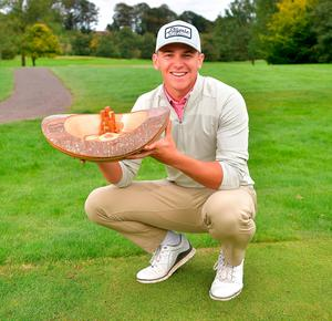 All smiles: Tyler Koivisto gets to grips with the trophy in Ballymena