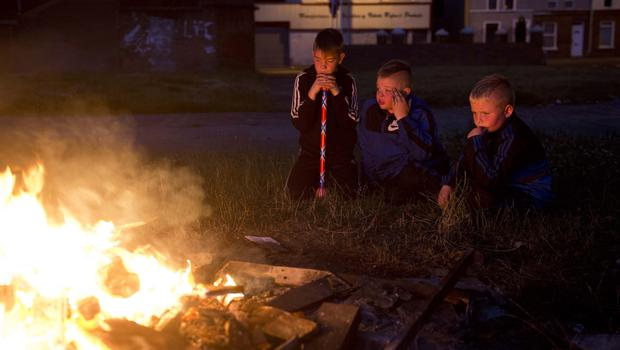 Loyalist area's across Northern Ireland get ready to kick off the 12th of July celebrations with the traditional bonfires. Mark Marlow/Pacemaker Press. Pictured are Matthew Dixon with Ryan and Gary Ashwood in south Belfast. Pic: Mark Marlow/Pacemaker Press.