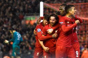 Liverpool's Welsh midfielder Joe Allen (C) celebrates with teammates after scoring during the English Premier League football match between Liverpool and Arsenal at Anfield stadium in Liverpool, north-west England on January 13, 2016. AFP PHOTO / PAUL ELLIS RESTRICTED TO EDITORIAL USE. NO USE WITH UNAUTHORIZED AUDIO, VIDEO, DATA, FIXTURE LISTS, CLUB/LEAGUE LOGOS OR 'LIVE' SERVICES. ONLINE IN-MATCH USE LIMITED TO 75 IMAGES, NO VIDEO EMULATION. NO USE IN BETTING, GAMES OR SINGLE CLUB/LEAGUE/PLAYER PUBLICATIONS.PAUL ELLIS/AFP/Getty Images