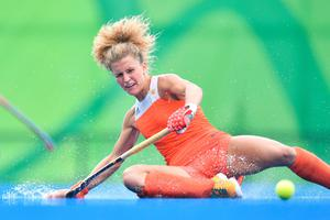 TOPSHOT - Netherlands' Maria Verschoor slips on the rain water during the womens's field hockey New Zealand vs Netherlands match of the Rio 2016 Olympics Games at the Olympic Hockey Centre in Rio de Janeiro on August, 12 2016. / AFP PHOTO / Carl DE SOUZACARL DE SOUZA/AFP/Getty Images
