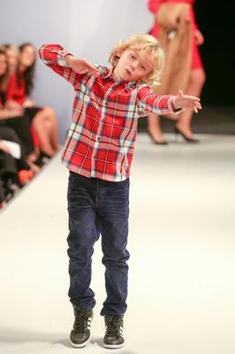 West Coast Cooler Fashion Week. Pictured: Patrick in a Red Checked Shirt and Blue Cord Trousers from M&S dabs at the end of the catwalk. Picture: Philip Magowan / PressEye (21st October 2016)