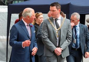 The Prince of Wales speaking with the new Lord Mayor of Belfast John Finucane  during a visit to The Bank Buildings in Belfast, where a fire broke out in a Primark store in August 2018, nearly caused the iconic structure to collapse. PRESS ASSOCIATION Photo. Picture date: Wednesday May 22, 2019. See PA story ROYAL Tour. Photo credit should read: Liam McBurney/PA Wire
