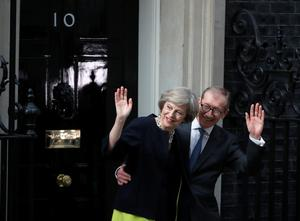 Newly appointed Prime Minister Theresa May with her husband Philip arrives to take up residence in 10 Downing Street on July 13, 2016 in London, England. Former Home Secretary Theresa May becomes the UK's second female Prime Minister after she was selected unopposed by Conservative MPs to be their new party leader. She is currently MP for Maidenhead.  (Photo by Christopher Furlong/Getty Images)