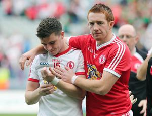 Disappointed Tyrone players Conor McAliskey and Michael O'Neill after the game