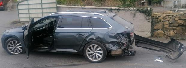 The damage caused to the police car.