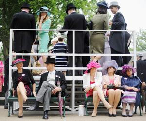 ASCOT, ENGLAND - JUNE 20:  Racegoers in the Winning Post Gazebos during Ladies' Day on day three of Royal Ascot at Ascot Racecourse on June 20, 2013 in Ascot, England.  (Photo by Stuart C. Wilson/Getty Images for Ascot Racecourse)