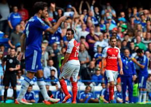 Arsenal's Spanish midfielder Santi Cazorla (2nd L) reacts after being sent off during the English Premier League football match between Chelsea and Arsenal at Stamford Bridge in London on September 19, 2015. AFP PHOTO / BEN STANSALL  RESTRICTED TO EDITORIAL USE. No use with unauthorized audio, video, data, fixture lists, club/league logos or 'live' services. Online in-match use limited to 75 images, no video emulation. No use in betting, games or single club/league/player publications.BEN STANSALL/AFP/Getty Images