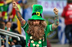 A Northern Ireland fan in the stands during the UEFA European Championship Qualifying match at Windsor Park, Belfast. PRESS ASSOCIATION Photo. Picture date: Thursday October 8, 2015. See PA story SOCCER N Ireland. Photo credit should read: Niall Carson/PA Wire.