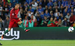 Portugal's Cristiano Ronaldo fires a shot  during the Euro 2016 Group F soccer match between Portugal and Iceland at the Geoffroy Guichard stadium in Saint-Etienne, France, Tuesday, June 14, 2016. (AP Photo/Laurent Cipriani)