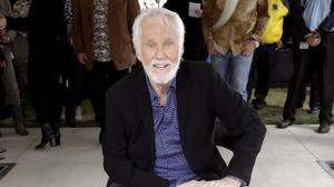 Kenny Rogers, pictured with his star on the Music City Walk of Fame in Nashville, Tennessee, has died at 81 (Mark Humphrey/AP)