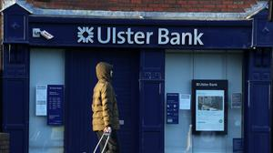 A man passes an Ulster Bank branch in Raheny, Dublin (Brian Lawless/PA)
