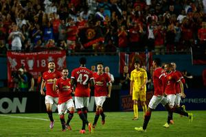 Juan Mata #8 of Manchester United celebrates his goal with his teammates against Liverpool in the Guinness International Champions Cup 2014 Final at Sun Life Stadium on August 4, 2014 in Miami Gardens, Florida. United defeated Liverpool 3-1. (Photo by Chris Trotman/Getty Images)