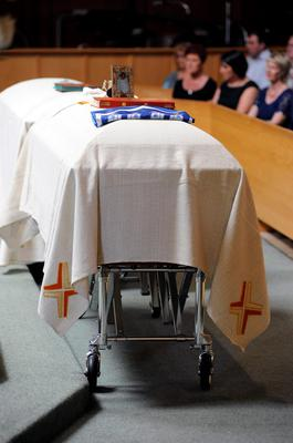 Caskets of Olivia Burke, 21, and Ashley Donohoe, 22, are set in front of the altar before a service at St. Josephs Catholic Church in Cotati, Calif., on Saturday, June 20, 2015.  The two woman were among the several people killed on Tuesday when a balcony snapped off the fifth floor of a Berkeley apartment building during a birthday party. (AP Photo/Michael Short)
