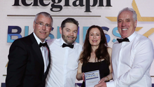 Tony Convery and Brendan Maynes from CDE with the Outstanding Business of the Year award, presented by Richard Donnan, Ulster Bank, and Gail Walker, Belfast Telegraph