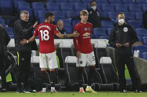 Manchester United manager Ole Gunnar Solskjaer congratulates Bruno Fernandes as he is substituted (Alastair Grant/NMC Pool/PA)