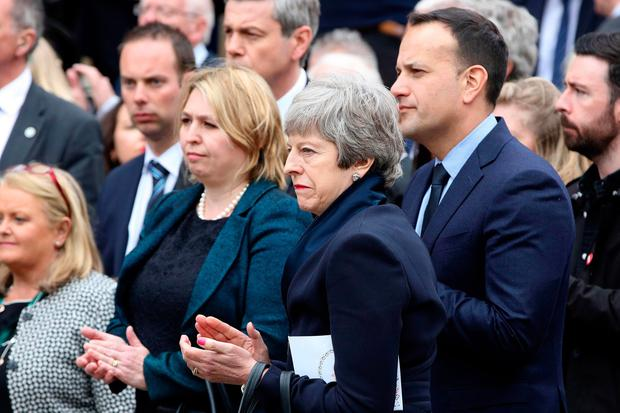 Irish Prime minister Leo Varadkar (R) and Prime Minister Theresa May (C) leave St Anne's Cathedral in Belfast on April 24, 2019, after attending the funeral service of journalist Lyra McKee (Photo by Paul Faith / AFP/Getty Images)