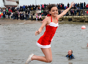 Flashback - Christmas and New Year swims in Northern Ireland: Swimmers take the plunge in the annual New Year's Day swim at Carnlough harbour.