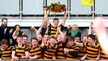 RBAI captain captain Lewis McNamara lifts the Danske Bank Ulster Schools' Cup after defeating Wallace High School in the Kingspan Final.