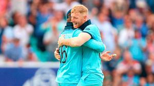 Game over: England's Ben Stokes celebrates the final wicket of South Africa's Imran Tahir on Thursday with Eoin Morgan
