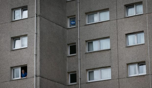 EDINBURGH, SCOTLAND - SEPTEMBER 16:  Yes posters are seen in windows in a block of flats in Edinburgh on September 16, 2014 in Edinburgh, Scotland. Yes and No supporters are campaigning in the last two days of the referendum to decide if Scotland will become an independent country.  (Photo by Matt Cardy/Getty Images)
