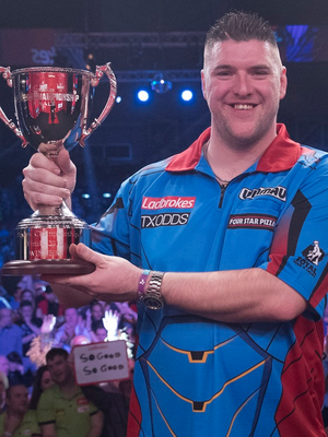 The NI darts ace shows off the Players' Championship trophy