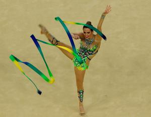 RIO DE JANEIRO, BRAZIL - AUGUST 19:  Natalia Gaudio of Brazil performs her ribbon routine during the Rhythmic Gymnastics Individual All-Around on August 19, 2016 at Rio Olympic Arena in Rio de Janeiro, Brazil.  (Photo by Elsa/Getty Images)