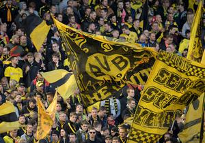 Borussia Dortmund fans wave flags before the UEFA Europa league quarter-final second leg football match between Liverpool and Borussia Dortmund at Anfield stadium in Liverpool on April 14, 2016. AFP/Getty Images