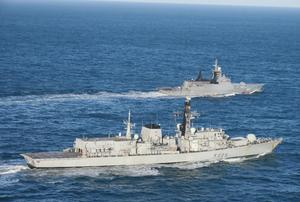 Handout photo issued by the Ministry of Defence (MoD) of the Russian corvette Boikiy (back) which was shadowed by HMS Lancaster as it sailed in waters around the UK (MoD/PA)
