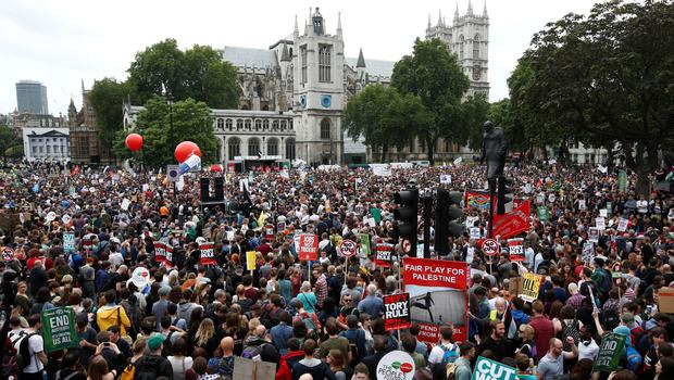 Demonstrators congregate in Parliament square to hear speeches at the end of a protest march against the British government's spending cuts and austerity measures in London on June 20, 2015. The national demonstration against austerity was organised by People's Assembly against government spending cuts.      AFP PHOTO / JUSTIN TALLISJUSTIN TALLIS/AFP/Getty Images