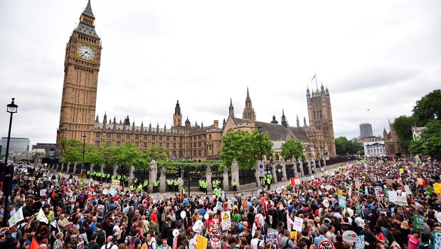 Thousands of demonstrators gather to hear speeches outside the Houses of Parliament during a protest against the British government's spending cuts and austerity measures in London on June 20, 2015. The national demonstration against austerity was organised by People's Assembly against government spending cuts.   AFP PHOTO / BEN STANSALLBEN STANSALL/AFP/Getty Images