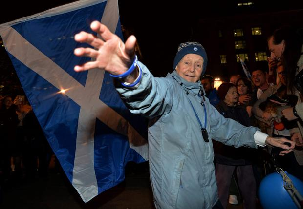 "Supporters at a ""Yes"" rally in George Square react on September 19, 2014 in Glasgow, Scotland.   (Photo by Mark Runnacles/Getty Images)"