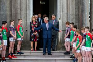 The Prince of Wales is given a guard of honour by pupils from St Patrick's Grammar School, Armagh and The Royal School, Armagh, after an engagement at Palace Demense in Co. Armagh.   PRESS ASSOCIATION Photo. Picture date: Wednesday May 22, 2019. See PA story ROYAL Tour. Photo credit should read: Liam McBurney/PA Wire