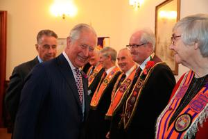 RETRANSMITTED WITH CORRECT  CAPTION  The Prince of Wales meeting members of the Lugan District Loyal Orange No.6, during his visit to Brownlow House, Lugan, on the second day of his tour of Northern Ireland.  PRESS ASSOCIATION Photo. Picture date: Wednesday May 22, 2019. See PA story ROYAL Tour. Photo credit should read: Owen Humphreys/PA Wire