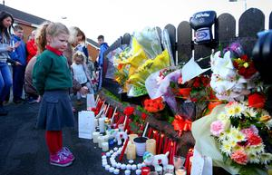 A candlelit vigil takes place in Summerhill, Twinbrook, west Belfast, where well-known boxer Eamonn Magee Jnr was stabbed to death.