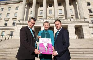 Northern Ireland- 3rd March 2014 Mandatory Credit - Photo-Jonathan Porter/Presseye.  Ovarian Cancer sufferer and campaigner Una Crudden hands in a petition to Health Minister Edwin Poots to try and increase awareness of the disease.  Mrs Crudden also spoke in the Senate Chamber of Parliament Buildings at Stormont to an audience which include the Health Minister.   Una Crudden with the Health Mionister Edwin Poots(left) and the Alliance Party's Chris Lyttle in front of Stormont.