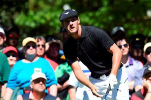 US golfer Bryson DeChambeau watches his tee shot during Round 1 of the 80th Masters Golf Tournament at the Augusta National Golf Club on April 7, 2016, in Augusta, Georgia.   / AFP PHOTO / Jim WatsonJIM WATSON/AFP/Getty Images