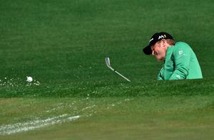 Wales's Jamie Donaldson hits out of a bunker on the 2nd hole during Round 1 of the 80th Masters Golf Tournament at the Augusta National Golf Club on April 7, 2016, in Augusta, Georgia.   / AFP PHOTO / Nicholas KammNICHOLAS KAMM/AFP/Getty Images