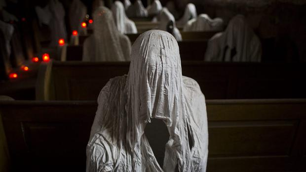 Ghost statues by artist Jakub Hadrava are placed at the St. George's church near Plzen on November 16, 2014 in Lukova, Czech Republic.  (Photo by Matej Divizna/Getty Images)